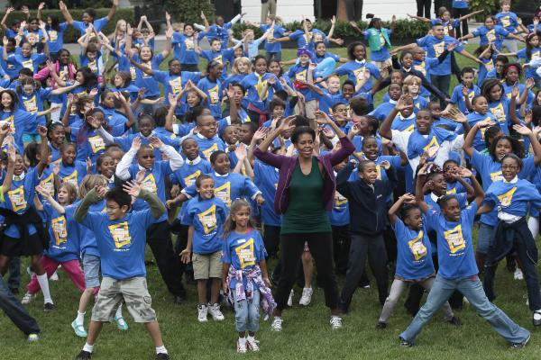 <strong>Let's move:</strong> Michelle and a group of children try to break the Guinness World Record for the most people doing jumping jacks in a 24-hour period, at the White House on Oct. 11, 2011. Michelle's anti-obesity campaign, Let's Move, focuses on teaching children good nutrition and regular exercise.
