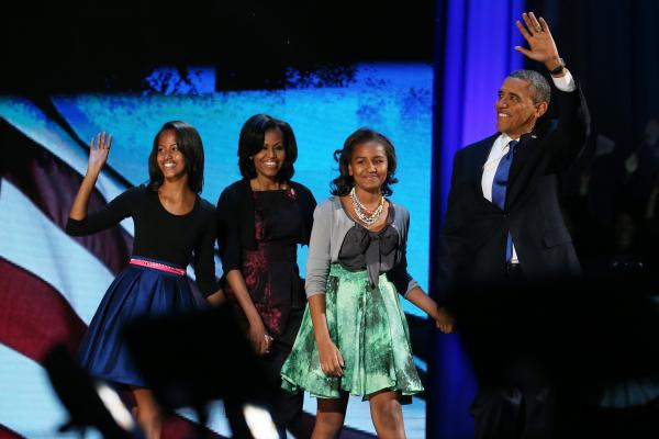 <strong>First family:</strong> Obama walks on stage with his family to deliver his victory speech on election night on Nov. 6, 2012, in Chicago.