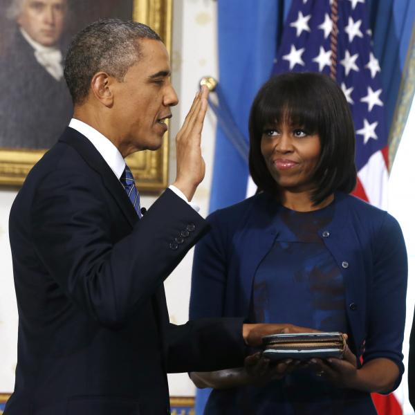 President Obama is officially sworn-in Sunday by Chief Justice John Roberts, as first lady Michelle Obama holds the Robinson family Bible.