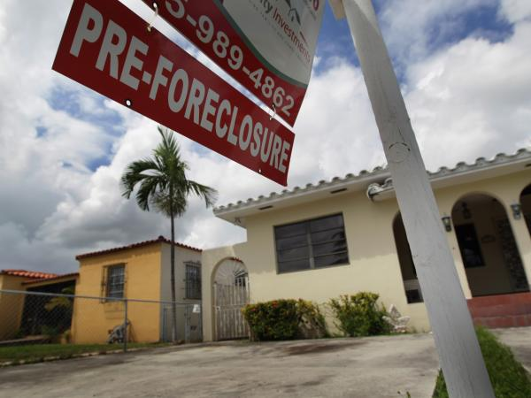 A sign hangs outside a house in Miami in 2010. Currently, Florida's foreclosure legal process can take a couple of years, which critics say is hurting the housing market.