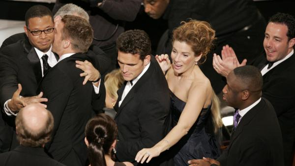The cast of <em>Crash</em> celebrates after its surprise upset of <em>Brokeback Mountain</em> for best picture, at the 78th Academy Awards in 2006.