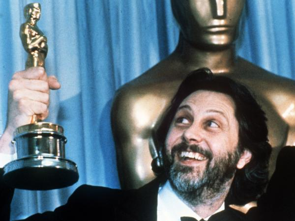 David Putnam, producer of <em>Chariots of Fire</em>, holds up his Oscar after the movie won best picture in 1982.