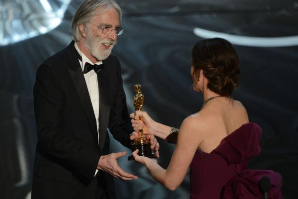 "Michael Haneke accepts the Oscar for ""Amour,"" best foreign language film, from Jennifer Garner."