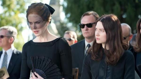 Evelyn and India Stoker (Nicole Kidman and Mia Wasikowska) slowly descend into icy paranoia after their family patriarch dies through suspicious circumstances in the horror thriller <em>Stoker</em>.