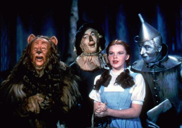 Bert Lahr as the Cowardly Lion, Ray Bolger as the Scarecrow, Judy Garland as Dorothy, and Jack Haley as the Tin Man in the best-known version of <em>The Wizard Of Oz</em>