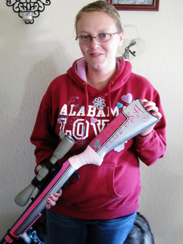 Corcoran holds a Ruger 10/22 rifle that she and her husband outfitted. The Army sergeant encountered combat on her first patrol during a yearlong deployment in Afghanistan.