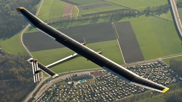 The Solar Impulse, a solar-powered plane, flies over Switzerland. The makers will be journeying across the U.S. this spring, hoping the flight helps challenge assumptions about what solar technology can do.