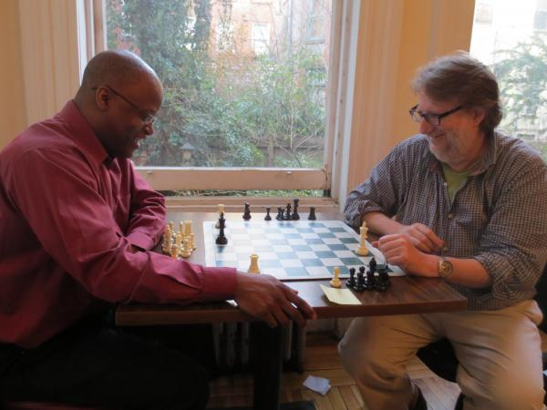 <em></em> Very Important Puzzler Maurice Ashley gives Ask Me Another grand prize winner Andy Cohen a chess lesson at the Marshall Chess Club in New York City.