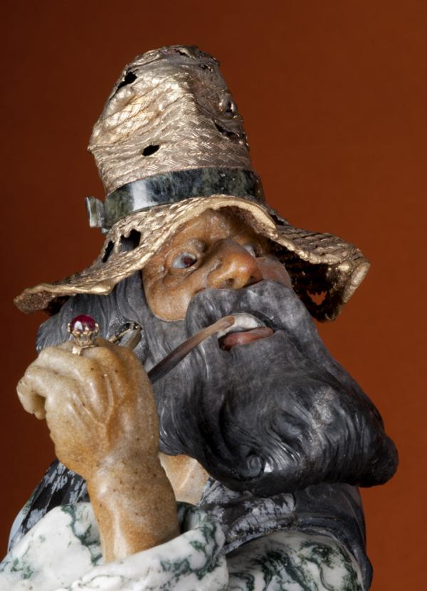 A close-up of the man in <em><em>Gypsies,</em></em> one of the last sculptures Konovalenko made, shows the artist's extraordinary level of detail. The veins and the tendons are visible on the man's hand. His hat is gold-plated silver; his eyes and ring are ruby; his face is Beloretsk quartz.
