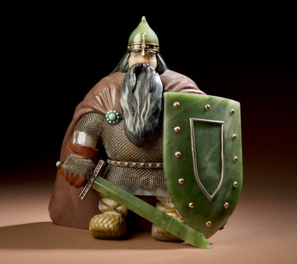 "<em><em>Warrior</em></em> is a classic Russian piece created in 1961. His shield and sword are nephrite, which Konovalenko loved to carve, for it had ""special qualities like no other stone."""