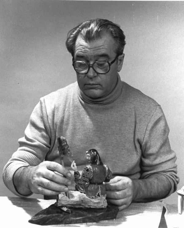 Set designer turned sculptor Vasily Konovalenko (ca. 1984) is seen with a work titled <em>Grandmother</em>.