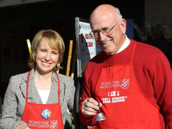Tucson Mayor Bob Walkup poses with then-U.S. Rep. Gabrielle Giffords during a Salvation Army fundraiser about a year before she was shot in the head.
