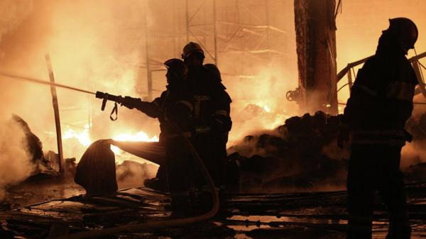 Firefighters battling the blaze at a psychiatric hospital north of Moscow early Friday.