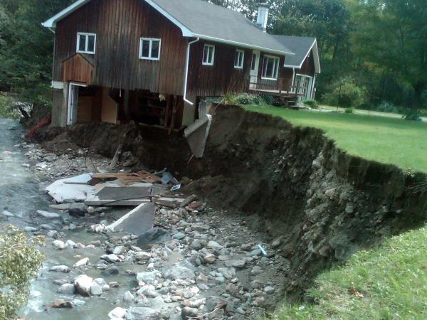 A house destroyed by Tropical Storm Irene sits in Rochester, Vt., in 2011.