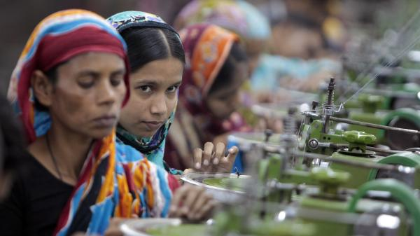 Workers manufacture clothing in a factory near Dhaka, Bangladesh, in December. Labor activists and major clothing retailers met in Germany this week to try to hammer out a deal that would improve working conditions in Bangladeshi factories.
