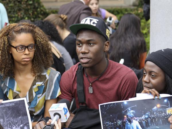 Teremy Jackson, a sophomore at USC who was at the party, speaks to reporters at an on-campus protest on Monday.