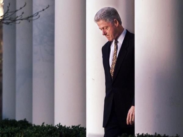 President Clinton walks to the White House Rose Garden to deliver a statement on the impeachment inquiry on Dec. 11, 1998.
