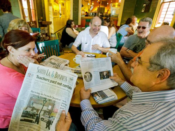 A year later, these friends are still gathering to talk over the paper, but it's not <em>The Times-Picayune.</em> From left: Sue Paraski, Sharon Morrow, Eric Hartman, Joe Mole.