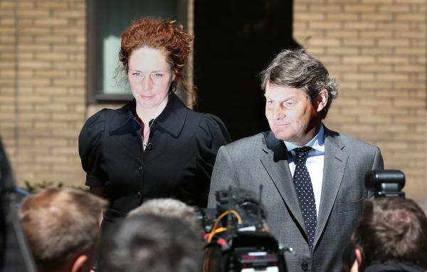 Rebekah Brooks, left, the former Chief Executive of News International, and her husband Charlie Brooks leave Southwark Crown Court on Wednesday in London, England.