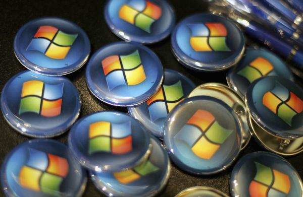 Buttons with the Microsoft logo are seen at a Comp USA store in 2007.