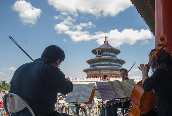 Artists from the Philadelphia Orchestra perform at the Temple of Heaven in Beijing, capital of China.