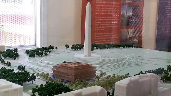 Oprah Winfrey gave $12 million Tuesday to help build the Smithsonian's new National Museum of African American History and Culture, seen here in a scale model (lower center). The facility is expected to open in 2015.