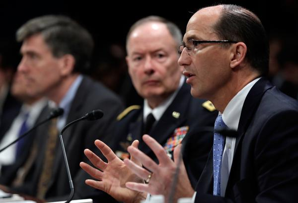 Sean Joyce, right, deputy director of the Federal Bureau of Investigation testifies before the House Select Intelligence Committee on Tuesday.