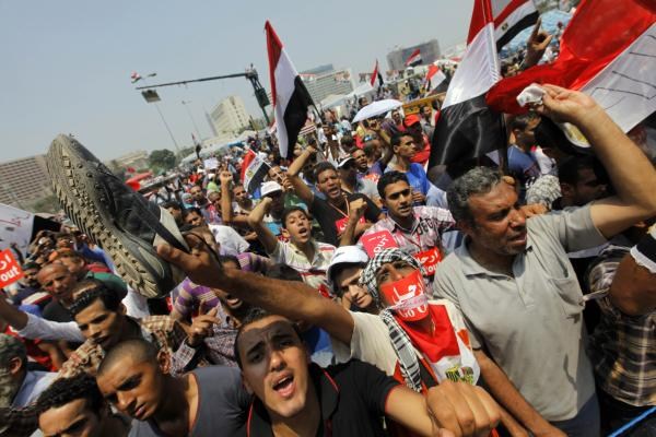 Protesters gather at Tahrir Square. Morsi remained defiant as the military pressed the president and his political opponents to strike a compromise.