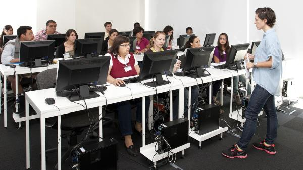 New employees train for call center work at Teleperformance Portugal, an outsourcing company in Lisbon. The outsourcing industry is adding thousands of jobs while other Portuguese industries shed them.