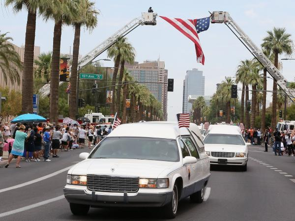 "On Sunday in Phoenix, the 19 bodies of firefighters killed while battling a wildfire in central Arizona were driven to Prescott, where the ""hotshot"" team was based."