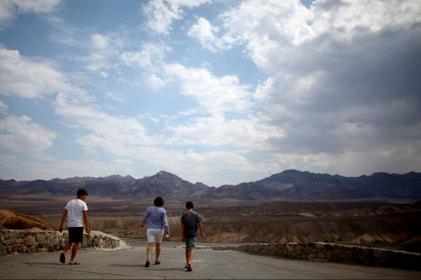 A family walks away from Zabriskie Point.