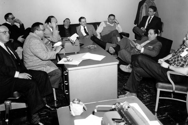 Caesar and some of his staff plan the comedy show <em>Caesar's Hour</em> in New York City in 1955. From left: Dave Caesar, Charles Andrews, Phil Sharp, Carl Reiner, Howard Morris, Aaron Ruben, Mel Tolkin, Mike Ross, Sid and Sheldon Keller.