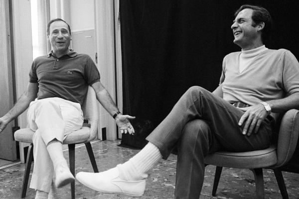 Comedian and writer Mel Brooks (left) sits with Caesar for the <em>Sid Caesar Special</em> in 1967.