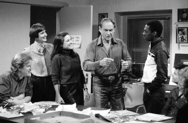 Caesar with<em> Saturday Night Live</em> writer Brad Hall (from left), Mary Gross, Julia Louis-Dreyfus, Eddie Murphy and Gary Kroeger on the set of <em>Saturday Night Live</em> in 1983 in New York.