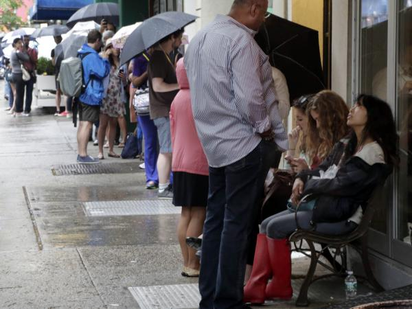 Hopeful customers line up outside New York's Dominique Ansel Bakery to purchase cronuts.