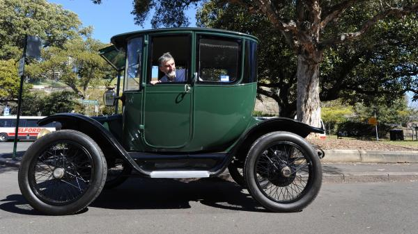 Vintage car collector Bill Lloyd shows off his Detroit Electric model from 1915, in Australia last year.