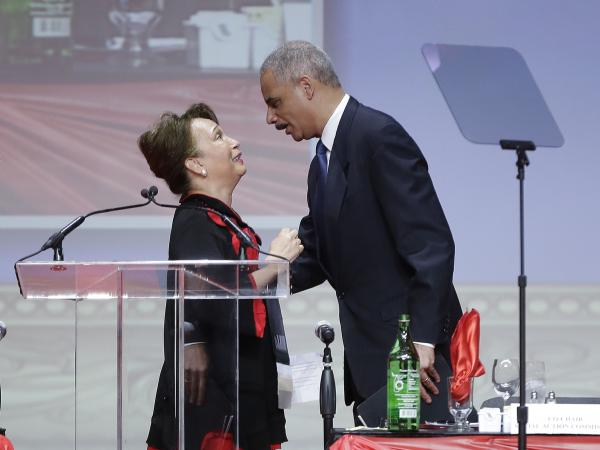 Attorney General Eric Holder greets Alexis Margaret Herman, member of the Delta Sigma Theta sorority, before speaking at the organization's convention.