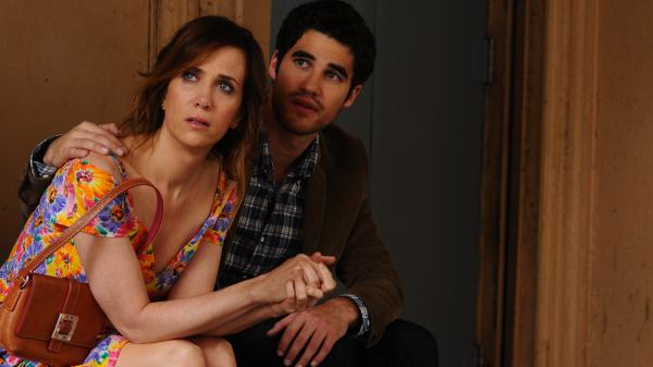 Kristen Wiig (with Darren Criss) stars in <em>Girl Most Likely </em>as a hard-luck case who learns how to reboot her disastrous life after she's forced to move back in with her mom.
