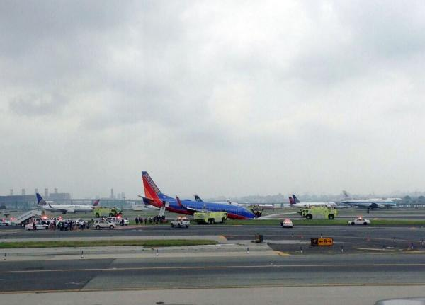 This photo provided by Bobby Abtahi, shows what officials say was a plane where the nose gear collapsed during landing at New York's LaGuardia Airport on Monday.