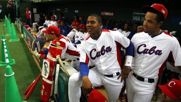 Cuba's team at the World Baseball Classic in Tokyo on March 8. More than 200 Cuban players have defected to the U.S. over the past two decades, and smugglers are increasingly involved in getting the players off the island, according to U.S. baseball agents.