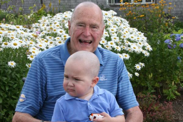 George H.W. Bush with Patrick, the two-year-old son of one of the members of his security detail.