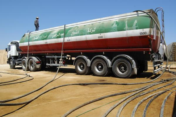 A fuel truck loads up from gas pumped illegally to Gaza from Egypt.