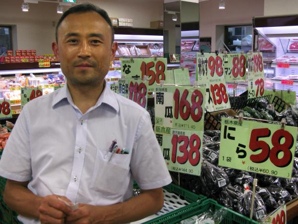 Tatsuhiro Mizuno runs a supermarket in the working-class neighborhood of Kameido. He says he hasn't seen much change in sales recently, although he notes that imported foods are now more expensive.