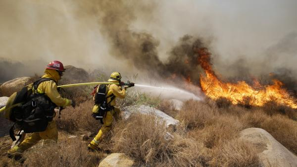 Firefighters battle a wildfire earlier this month in Cabazon, Calif.