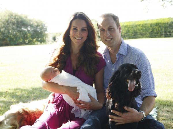 "In a second ""first"" photo of Prince George, the family's dogs joined in. Tilly, a retriever, is to the Duchess of Cambridge's right. Lupo, a cocker spaniel, is beside the duke."
