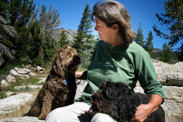 Judith Curry with her dogs, Rosie (left) and Bruno, in the mountains near Lake Tahoe. The climatologist focuses on the uncertainties of climate change far more than on the consensus of climate scientists.