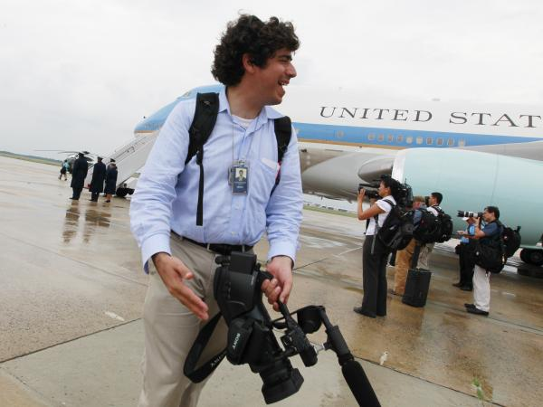 White House videographer Arun Chaudhary stands in front of Air Force One in 2010.