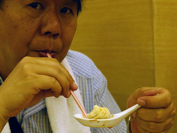 Looks like a good way to eat a soup dumpling, but it's only a straw man.