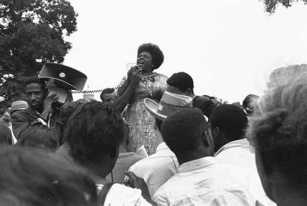 Mrs. Fannie Lou Hamer speaks to Mississippi Freedom Democratic Party sympathizers outside the Capitol in Washington, D.C., on Sept. 17, 1965. The House of Representatives had rejected a challenger to the 1964 election of five Mississippi representatives. Mrs. Hamer and two other African-American women were seated on the floor of the House while the challenge was being considered.