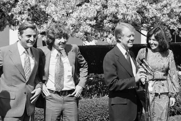 President Jimmy Carter talks to members of ACTION during a speech in the White House Rose Garden in 1977. From left are, Vice President Walter Mondale; Sam Brown, director of ACTION; Carter; and Mary King, deputy director of ACTION. About 25 percent of SNCC's members were white, including King, who applied her leadership experience from the SNCC to the feminist movement.